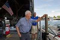 Jack and Bill Irwin at the gas docks at Irwin Marine on Lake Winnipesaukee in Laconia.  (Karen Bobotas for New England Boating Magazine)