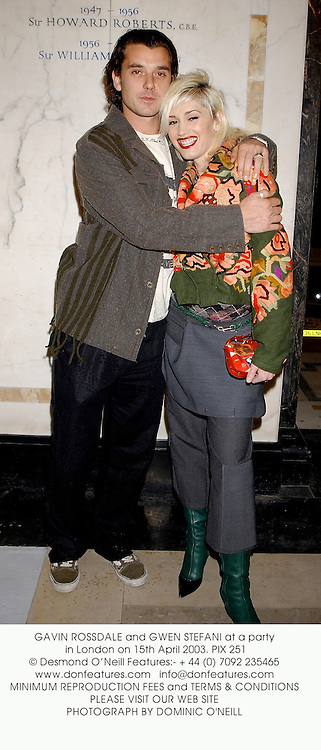 GAVIN ROSSDALE and GWEN STEFANI at a party in London on 15th April 2003. PIX 251