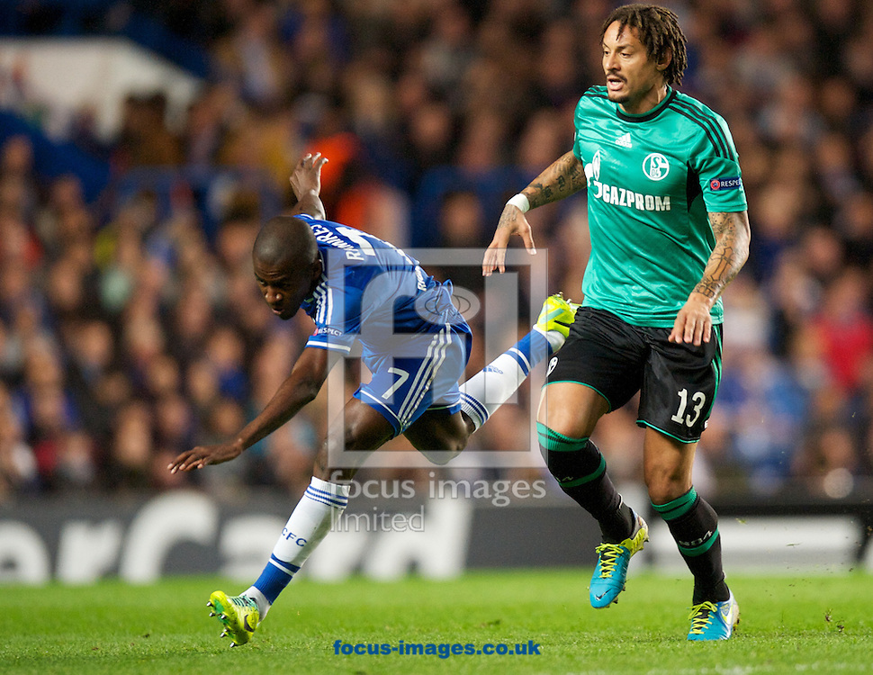 Picture by Alan Stanford/Focus Images Ltd +44 7915 056117<br /> 06/11/2013<br /> Ramires of Chelsea is tripped by Jermaine Jones of FC Schalke 04 during the UEFA Champions League match at Stamford Bridge, London.