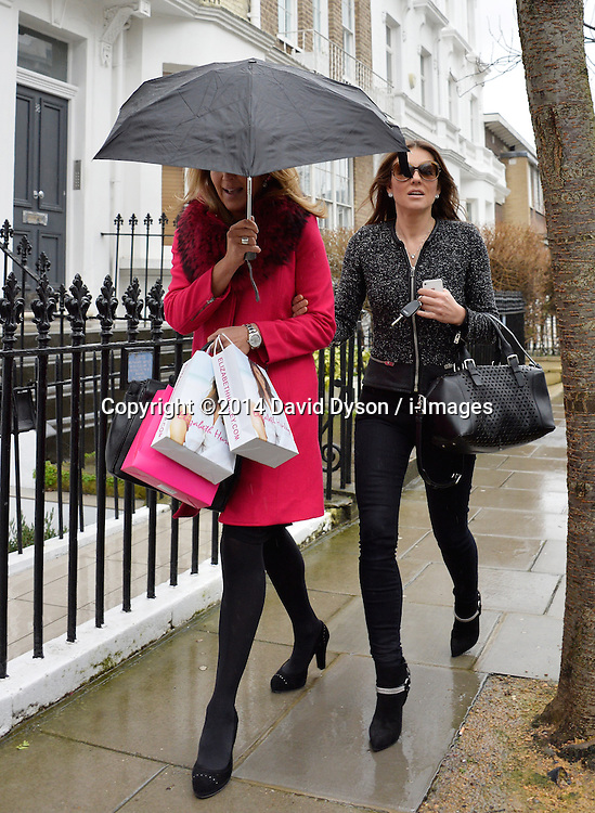 Elizabeth Hurley (R) leaves her West London home in London, United Kingdom. Thursday, 6th February 2014. Picture by David Dyson / i-Images