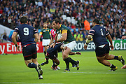 South Africa's Bismark Du Plessis getting tackled during the Rugby World Cup Pool B match between South Africa and USA at the Queen Elizabeth II Olympic Park, London, United Kingdom on 7 October 2015. Photo by Matthew Redman.