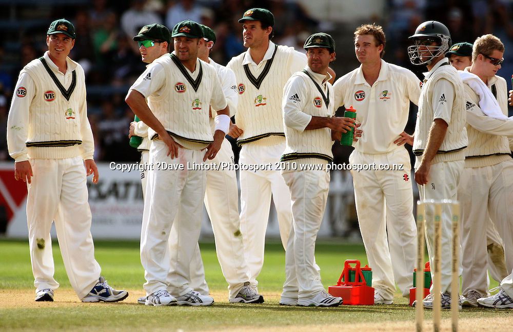 The Australian team wait for a player review of Nathan Hauritz' appeal for lbw on Ross Taylor.<br /> 1st cricket test match - New Zealand Black Caps v Australia, day three at the Basin Reserve, Wellington.Sunday, 21 March 2010. Photo: Dave Lintott/PHOTOSPORT