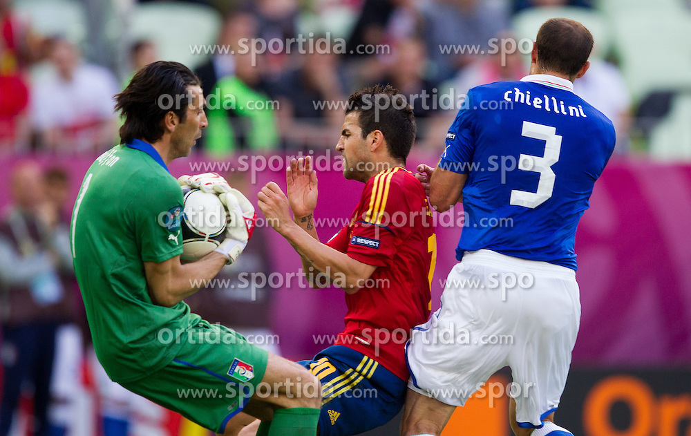 Cesc Fabregas of Spain between Gianluigi Buffon of Italy and Giorgio Chiellini of Italy during the UEFA EURO 2012 group C match between Spain and Italy at The Arena Gdansk on June 10, 2012 in Gdansk, Poland.  (Photo by Vid Ponikvar / Sportida.com)