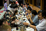 "Customers enjoy dinner aboard a ""Yakata-bune"" pleasure boat run by the Yasuda family in Tokyo, Japan on 30 August  2010. .Photographer: Robert Gilhooly"