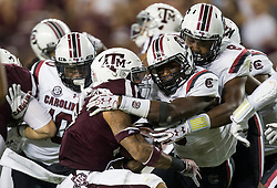 Texas A&M running back Trayveon Williams (5) is tackled by a swarm of South Carolina defenders during the second quarter of an NCAA college football game Saturday, Sept. 30, 2017, in College Station, Texas. (AP Photo/Sam Craft)