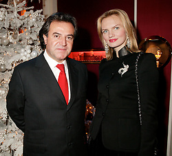 MR & MRS SIMON HALABI he is the wealthy property developer at Garrard's Winter Wonderland party held at their store 24 Albermarle Street, London W1 on 30th November 2006.<br />