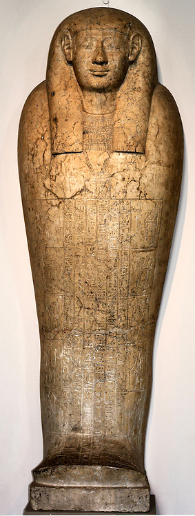 Anthropoid coffin lid of Padihorhephep. Made of Limestone. Ptolemaic period (approx. 200 BC) Egyptian. The pectoral shows seated figures of Osiris, Isis and Horus, with the central text showing the four Sons of Horus and other funerary deities.