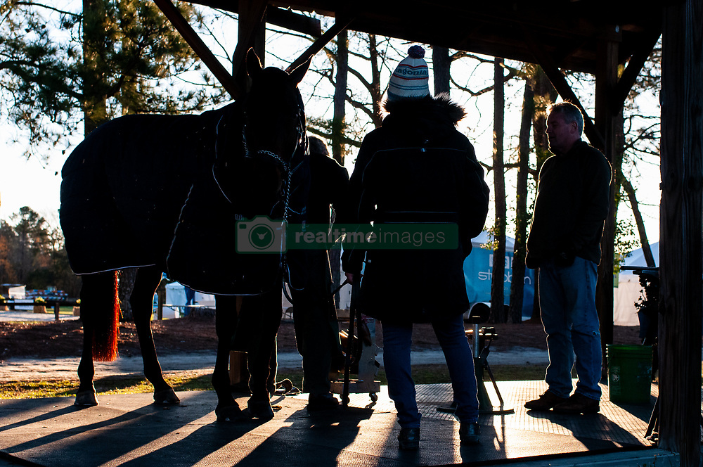 March 22, 2019 - Raeford, North Carolina, US - March 23, 2019 - Raeford, N.C., USA - Farriers shoe a horse as the sun rises at the sixth annual Cloud 11-Gavilan North LLC Carolina International CCI and Horse Trial, at Carolina Horse Park. The Carolina International CCI and Horse Trial is one of North AmericaÃ•s premier eventing competitions for national and international eventing combinations, hosting International competition at the CCI2*-S through CCI4*-S levels and National levels of Training through Advanced. (Credit Image: © Timothy L. Hale/ZUMA Wire)