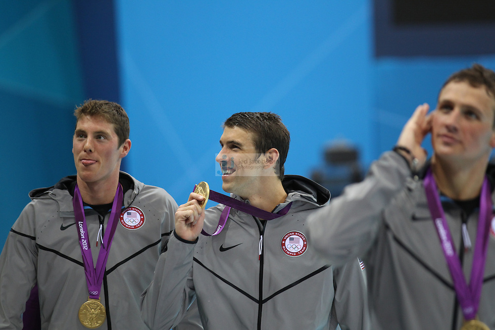Michael Phelps of the United States celebrates with the gold medal after the Men's 4 x 200m Medley Relay Final on Day 8 of the London 2012 Olympic Games at the Aquatics Centre on August 4, 2012 in London, England. (Jed Jacobsohn/for The New York Times)....