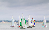 The Daring fleet gets underway on the opening day of Aberdeen Asset Management Cowes Week. The event began in in 1826 and plays a key part in the British sporting summer 'season'. It now stages up to 40 daily races for around 1,000 boats and is the largest sailing regatta of its kind in the world with 8,500 sailors competing.<br /> Picture date Saturday 2nd August, 2014.<br /> Picture by Christopher Ison. Contact +447544 044177 chris@christopherison.com