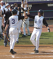 Kansas State's Joe Roundy (26) celebrates his go ahead three run homer in the bottom the eigth inning with teammate Jared Goedert.  Kansas State defeated Texas Tech 7-5 at Tointon Stadium in Manhattan, Kansas on April 16, 2005.