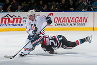 KELOWNA, CANADA - NOVEMBER 1: Calvin Thurkauf #27 of the Kelowna Rockets gets tripped up back checking Joe Gatenby #37 of the Kamloops Blazers as he skates with the puck during first period on November 1, 2016 at Prospera Place in Kelowna, British Columbia, Canada.  (Photo by Marissa Baecker/Getty Images)  *** Local Caption ***