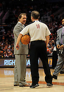 Dec. 5 2010; Phoenix, AZ, USA; Washington Wizards head coach Flip Saunders speaks with NBA Official Ron Garretson during the second half against the Phoenix Suns at the US Airways Center. The Suns defeated the Wizards 125-108. Mandatory Credit: Jennifer Stewart-US PRESSWIRE.