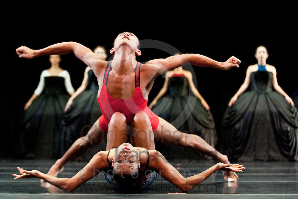 """Tulsa Ballet dancers Ma Cong and Soo Youn Cho in rehearsal for """"Petite Mort"""", originally choreographed by Jirí Kylián for the 1991 Salzburg Festival on the second centenary of Mozart's death...Tulsa Ballet Studios, Tulsa, Oklahoma -- August 2008."""