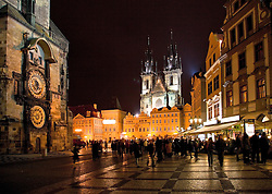 Prague, Czech Republic:  Old Town Square at night, with its famed Astronomical Clock on the far left and the fanciful steeples of Tyn Church in the background.