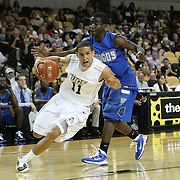 Isaac Sosa of the University of Central Florida Knights mens basketball team drives the ball against the West Florida Argonauts in the first home game of the 2010 season at the UCF Arena on November 12, 2010 in Orlando, Florida. UCF won the game 115-61. (AP Photo/Alex Menendez)