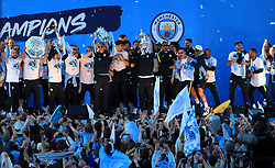 Manchester City players and staff on stage during the trophy parade in Manchester.
