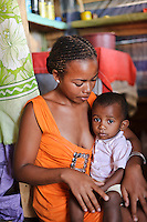 Young mother at a women's group meeting, Tanambao, Fort Dauphin, Madagascar.  Azafady's mission is to alleviate extreme poverty and protect endangered, biologically rich forest environments in Madagascar by empowering some of the poorest people to establish sustainable livelihoods and improve their health and wellbeing. Their aims are to raise awareness about the plight of the Madagascan environment and the Malagasy people; to empower Malagasy people to improve their own lives; and provide support to communities and threatened environments. Azafady's approach is one of co-operation and participation with grassroots communities working to alleviate the effects of poverty and to support viable, environmentally sensitive development. Their holistic development and conservation projects support some of the world's most vulnerable people in threatened & irreplaceable environments. At the heart of the charity's work is an integrated approach to the needs of the Malagasy people and their unique environment, sensitively built around what local people have told the charity are their most critical needs and which maximises community participation. Azafady develop projects using the Sustainable Livelihoods model for poverty reduction, which aims to reduce vulnerability by strengthening communities' human, natural, financial, social and physical assets with a caveat that the charity's projects and activities do not compromise the environment. Projects incorporate communication, training and support at the level of the Fokontany (village) and the household, with a priority for the most isolated and marginalised communities. The charity has recently recruited a Research, Monitoring and Evaluation Manager, who will implement Azafady's new HIV/AIDS activities with pregnant and married women, with the aim of reducing rates of maternal transmission of HIV within the town.