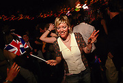 Girl with a union jack flag dancing at Come Dancing Battersea London June 2002