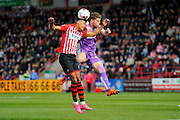 Exeter City's Ollie Watkins and Plymouth Argyle's Jordan Houghton during the Sky Bet League 2 match between Exeter City and Plymouth Argyle at St James' Park, Exeter, England on 2 April 2016. Photo by Graham Hunt.