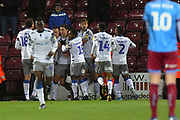 Colchester United celebrate goal scored by Colchester United player Luke Prosser(5) to go 2-2 during the EFL Sky Bet League 2 match between Scunthorpe United and Colchester United at Glanford Park, Scunthorpe, England on 14 December 2019.