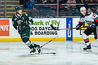 KELOWNA, BC - FEBRUARY 28: Jonas Peterek #27 of the Kelowna Rockets skates after Jake Christiansen #23 of the Everett Silvertips as he drops his stick after breaking it during a pass at Prospera Place on February 28, 2020 in Kelowna, Canada. (Photo by Marissa Baecker/Shoot the Breeze)