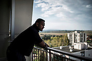 Soan, 16th BC French unit soldier looks at the landscape from his home balcony, on October 20, 2012 in Corbas. AFP PHOTO / JEFF PACHOUD