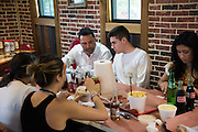 Oscar De La Hoya visits with his son, Devon, at Meat U Anywhere BBQ in Grapevine, Texas on September 16, 2016.  (Cooper Neill for ESPN)