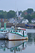 Scenic view of Digby, Nova Scotia Harbor on the Bay of Fundy with Scallop, Lobster,Halibut and Cod fishing boats common in the upperAtlantic coast. Scenic view of Digby, Nova Scotia Harbor on the Bay of Fundy with Scallop, Lobster,Halibut and Cod fishing boats common in the upperAtlantic coast.