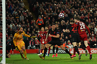 Football - 2019 / 2020 UEFA Champions League - Round of Sixteen, Second Leg: Liverpool (0) vs. Atletico Madrid (1)<br /> <br /> Liverpool's Andy Robertson heads the ball at goal, at Anfield.<br /> <br /> <br /> COLORSPORT/TERRY DONNELLY