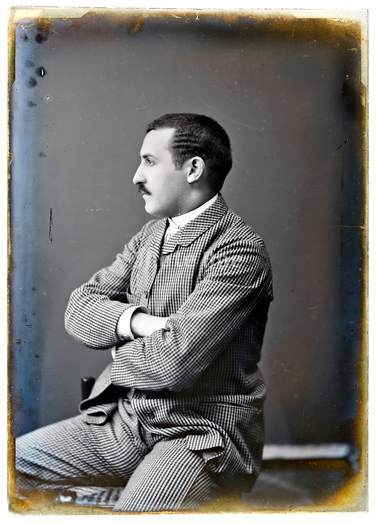 classic daylight studio portrait of man on a deteriorating glass plate France 1900s