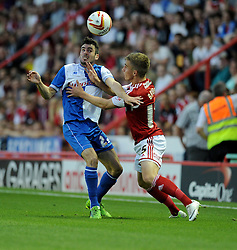 Bristol Rovers' Michael Smith battles for the ball with Bristol City's Joe Bryan  - Photo mandatory by-line: Alex James/JMP - Tel: Mobile: 07966 386802 04/09/2013 - SPORT - FOOTBALL -  Ashton Gate - Bristol - Bristol City V Bristol Rovers - Johnstone Paint Trophy - First Round - Bristol Derby