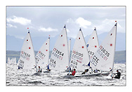 Women's fleet downwind..Opening races in breezy conditions for the Laser Radial World Championships, taking place at Largs, Scotland GBR. ..118 Women from 35 different nations compete in the Olympic Women's Laser Radial fleet and 104 Men from 30 different nations. .All three 2008 Women's Laser Radial Olympic Medallists are competing. .The Laser Radial World Championships take place every year. This is the first time they have been held in Scotland and are part of the initiaitve to bring key world class events to Britain in the lead up to the 2012 Olympic Games. .The Laser is the world's most popular singlehanded sailing dinghy and is sailed and raced worldwide. ..Further media information from .laserworlds@gmail.com.event press officer mobile +44 7775 671973  and +44 1475 675129 .
