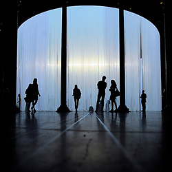 © licensed to London News Pictures. LONDON, UK.  08/08/11. Ron Arad's Curtain Call opens at the Roundhouse, Camden in London today (9th August 2011). Arad has installed a huge light curtain made of 5,600 silicon rods, suspended from an 18 metre diameter ring. Films, live performance and audience interaction can all take place within and around the rods. Mandatory Credit Stephen Simpson/LNP