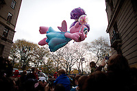 Macy's Thanksgiving Day Parade as seen from 74th St in New York. ..(Photo by Robert Caplin)....