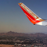 USA, Airzona, Phoenix. Southwest Airlines wing over Phoenix.
