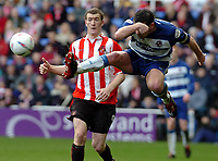 Picture: Henry Browne.<br />Date: 20/03/2004.<br />Reading v Sunderland Nationwide First Division.<br /><br />Reading's Graeme Murty flies in ahead of Sunderland's Kevin Kyle.