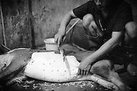 Preparation of traditional Balinese babi guling, near Ubud, Bali, Indonesia.
