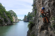 Rock Climbing on Cat Ba Island, Vietnam. Rising tides carved out these unique rock formations that are just beginning to become a sport climbing destination.
