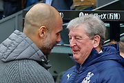 Crystal Palace Manager Roy Hodgson greets Manchester City Manager Pep Guardiola before the Premier League match between Crystal Palace and Manchester City at Selhurst Park, London, England on 14 April 2019.