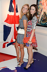 Left to right, KIMBERLY GARNER and EMMA MILLER at Ronnie Wood's Raw Instinct Summer Party held at Castle Fine Art, Bruton Street, London on 9th July 2013.