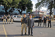 Belo Horizonte_MG, Brasil...O coronel da Policia Militar (PM) e o Delegado de Policia juntos no patio da sede do RISP (Regiao Integrada de Seguranca Publica) com policias civis e militares ao fundo...The colonel of the Military Police (MP) and Chief of Police together in the courtyard of RISP (Region Integrated Public Safety) with civilian police and military in the background...Foto: JOAO MARCOS ROSA / NITRO