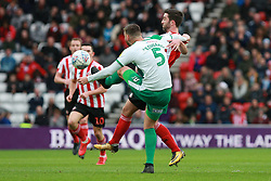 March 2, 2019 - Sunderland, England, United Kingdom - Sunderland's Will Grigg contests for the ball with Plymouth Argyle's Ryan Edwards during the Sky Bet League 1 match between Sunderland and Plymouth Argyle at the Stadium Of Light, Sunderland on Saturday 2nd March 2019. (Credit Image: © Mi News/NurPhoto via ZUMA Press)