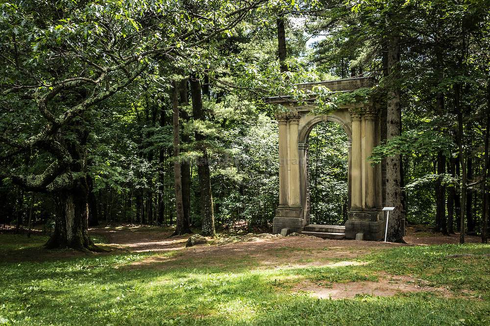 Mackenzie King Estate stone archway leading to the forest