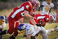 JEROME A. POLLOS/Press ..Kootenai High's Ben Shannon charges over the top of J.T. Wagner, from Garden Valley High, during Saturday's game in Harrison. The Warriors beat the Wolverines 54-26 to secure a spot in the 1A Championship game at the Kibbie Dome at the University of Idaho in Moscow.