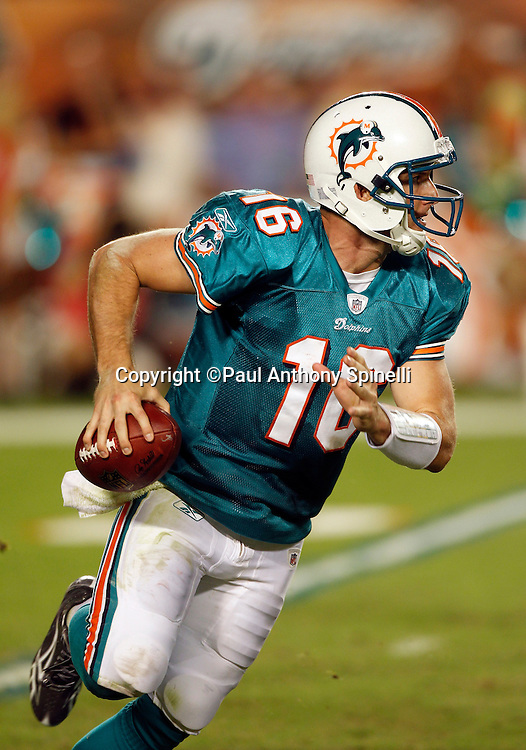 Miami Dolphins quarterback Tyler Thigpen (16) scrambles while looking to pass during the NFL week 11 football game against the Chicago Bears on Thursday, November 18, 2010 in Miami Gardens, Florida. The Bears won the game 16-0. (©Paul Anthony Spinelli)