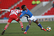 Kgosi Nthle clears during the The FA Cup 3rd round match between Doncaster Rovers and Rochdale at the Keepmoat Stadium, Doncaster, England on 6 January 2018. Photo by Daniel Youngs.