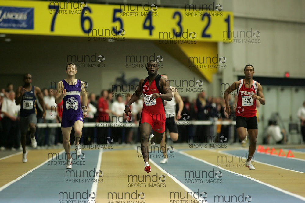 (Windsor, Ontario---12 March 2010) Sam Effah of University of Calgary Dinos   (140) Jason Kerr of University of Western Ontario Mustangs   (350) Dontae Richards-Kwok of York University Yoemen   (420)\ competes in the 300m final at the 2010 Canadian Interuniversity Sport Track and Field Championships at the St. Denis Center. Photograph copyright Sean Burges/Mundo Sport Images. www.mundosportimages.com