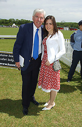 TOM O'CONNOR and his grandaughter AMY FULERTON at the Kuoni World Class Polo Day held at Hurtwood Park Polo Club, Surrey on 29th May 2005.<br />