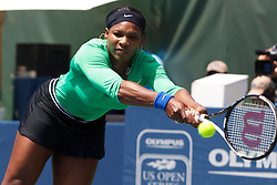 July 31, 2011; Stanford, CA, USA;  Serena Williams (USA) returns the ball against Marion Bartoli (FRA), not pictured, during the finals of the Bank of the West Classic women's tennis tournament at the Taube Family Tennis Stadium.